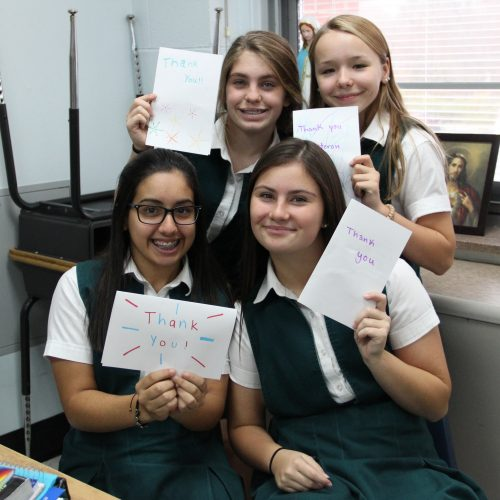 students holding thank you notes