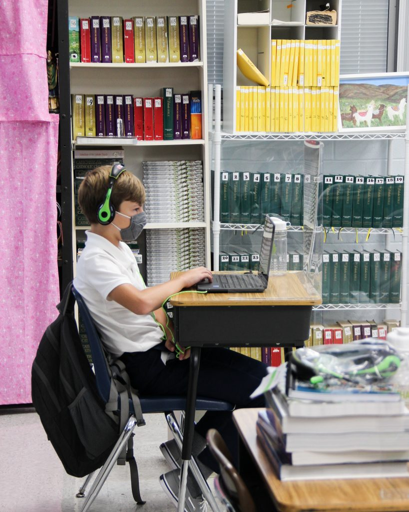 st. michael school student working at desk with mask on