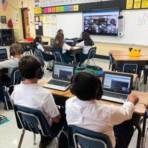 st. michael school students working on laptops